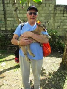 John White holding baby goat